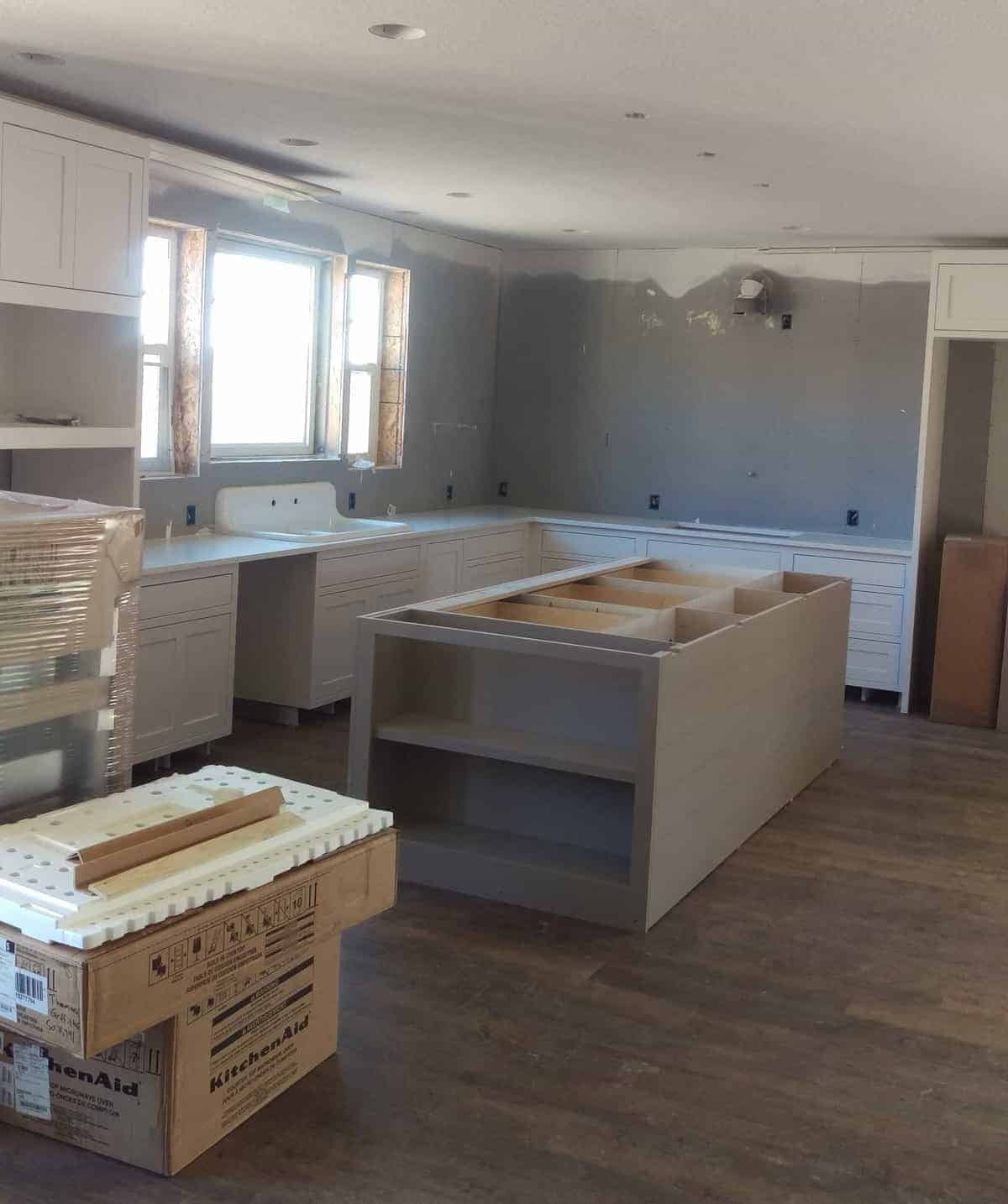 white cabinets and gray walls in the new kitchen