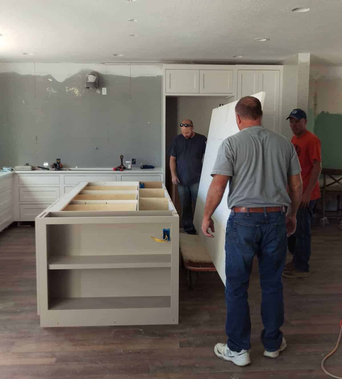 a large marble countertop being installed on the island in the kitchen