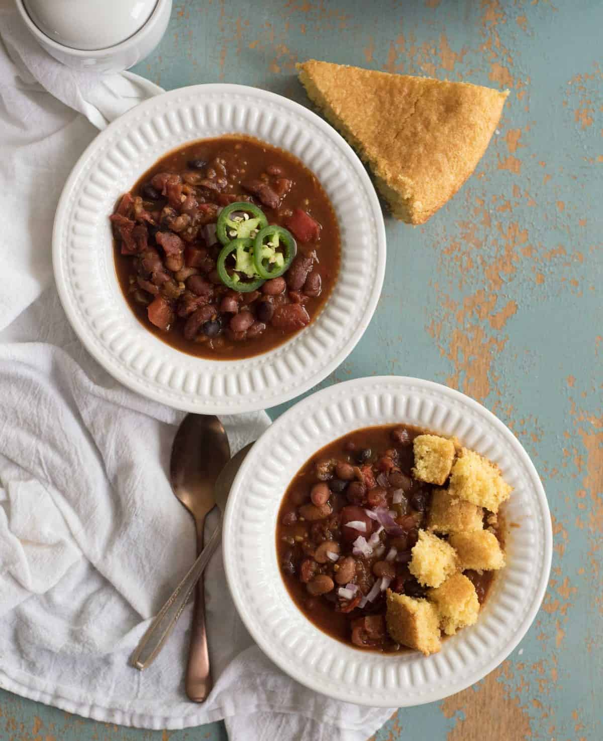 Healthy and flavorful Instant Pot Vegetarian Chili recipe made with a mix of dried beans, vegetables, spices, and a secret ingredient. A healthy one pot meatless meal your whole family will love.