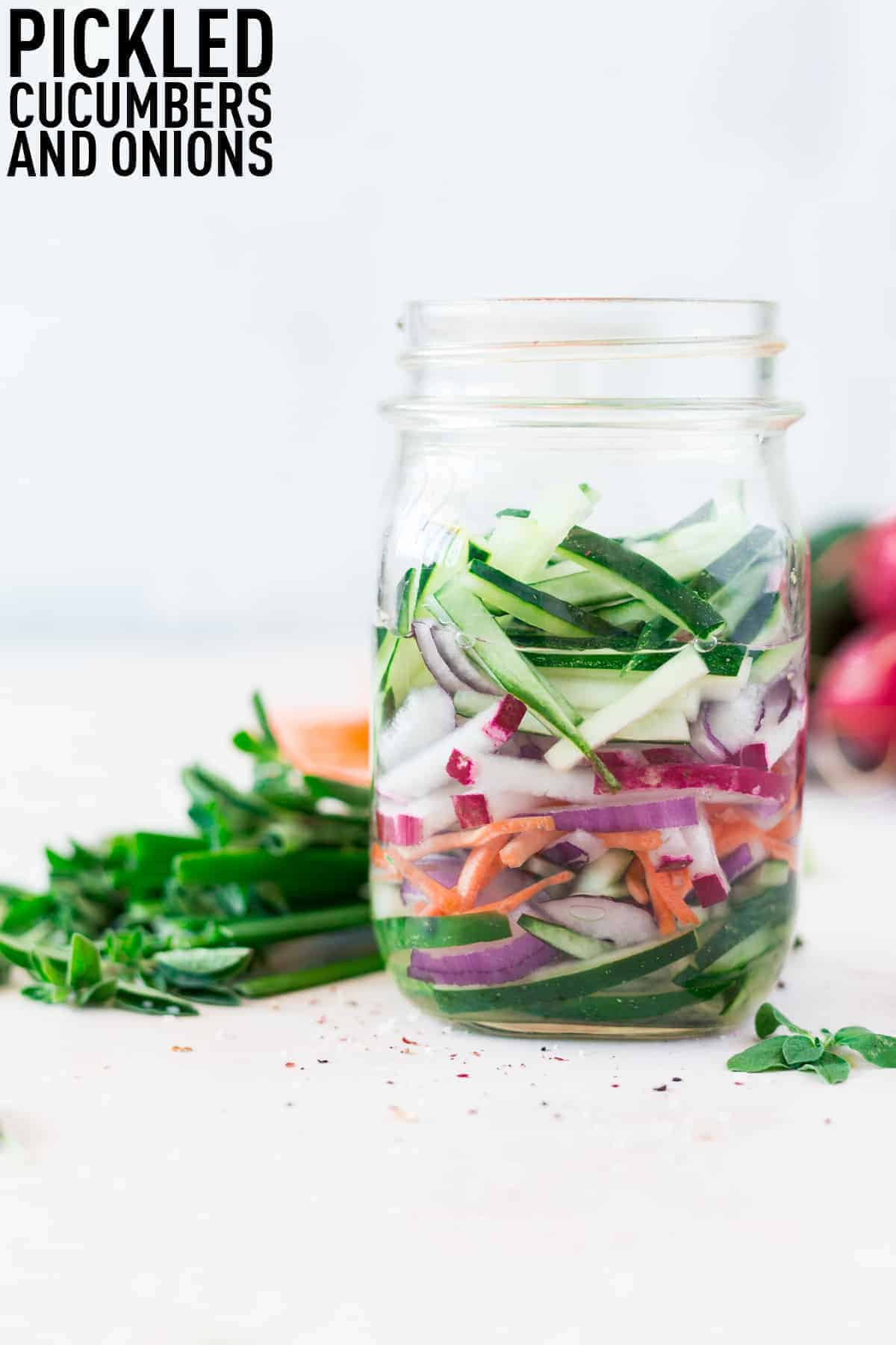 Quick pickled cucumbers and onions made with optional carrots and radishes make the perfect addition to salads, sandwiches, and more!