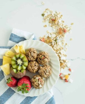 Image of No Bake Muesli Bites and Fruit on a Plate