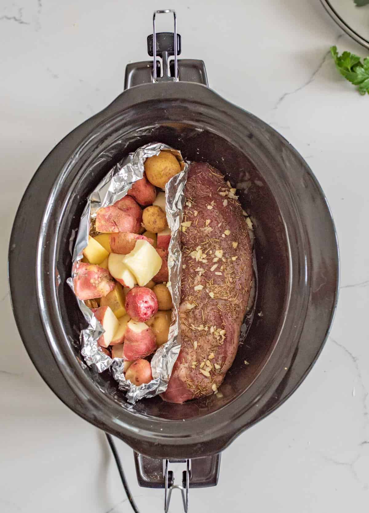 Slow Cooker Pork Tenderloin and Potatoes make the perfect simple dinner with moist and flavorful pork and potatoes that aren't over cooked or soggy.