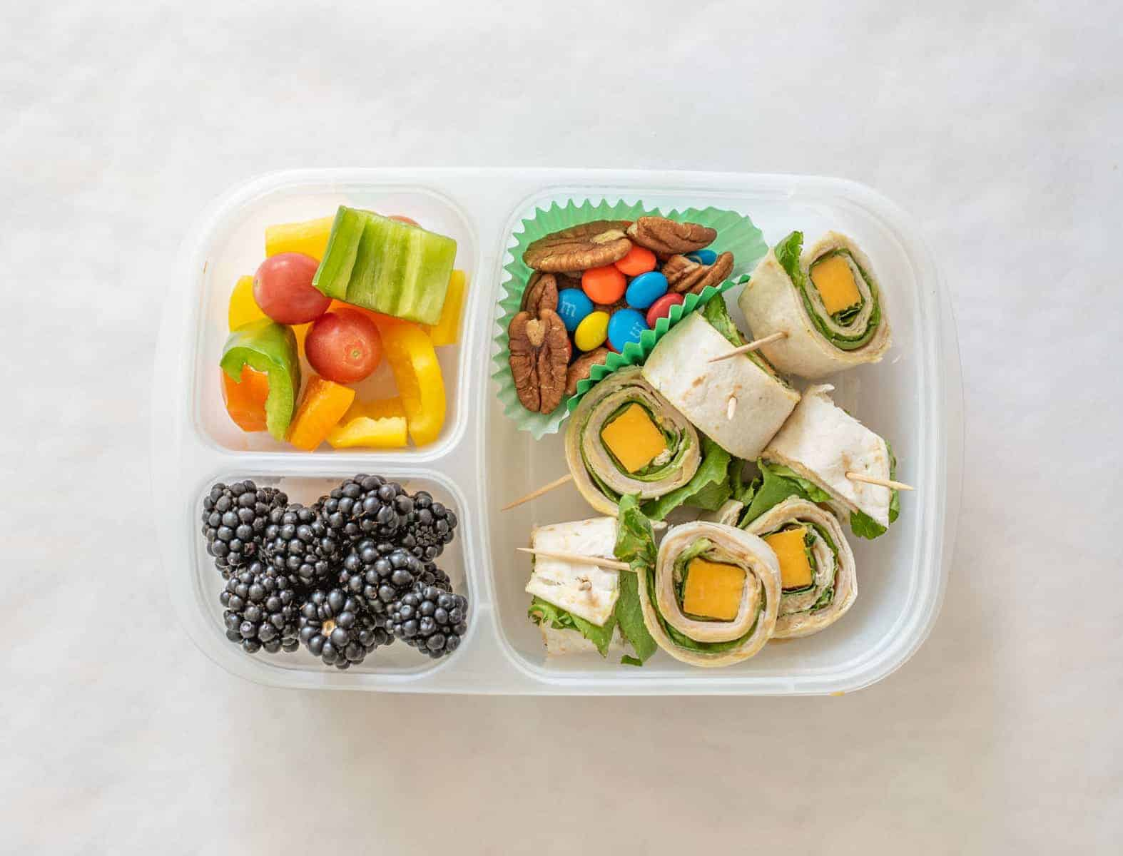 Quick and easy school and adult lunch box ideas made with Sabra Hummus, fruit, vegetables, and more.