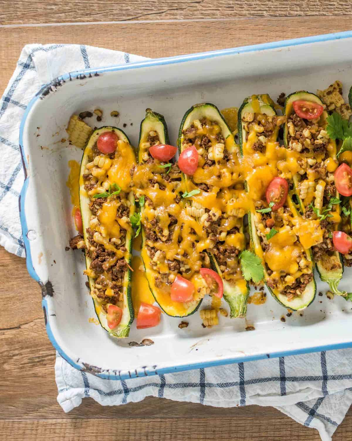 Quick and easy taco zucchini boats made with a simple taco meat and corn mixture, cheese, and zucchini and all done in about 30 minutes.
