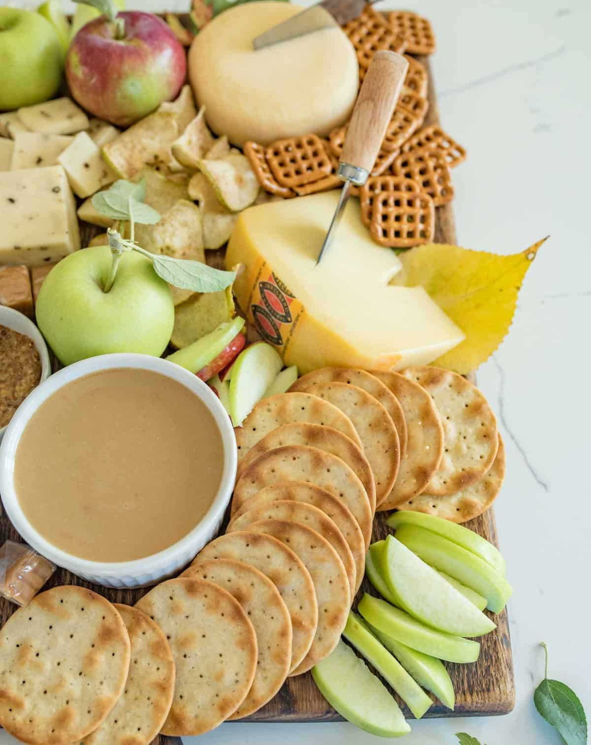 How to make a simple fall apple and cheese board that is perfect for snacking, an appetizer, parties, or just a slow evening in.
