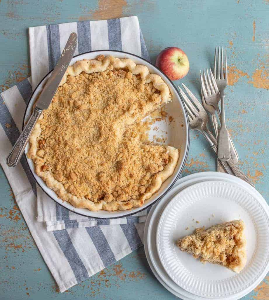 Image of a Dutch Apple Pie with One Slice on a Plate