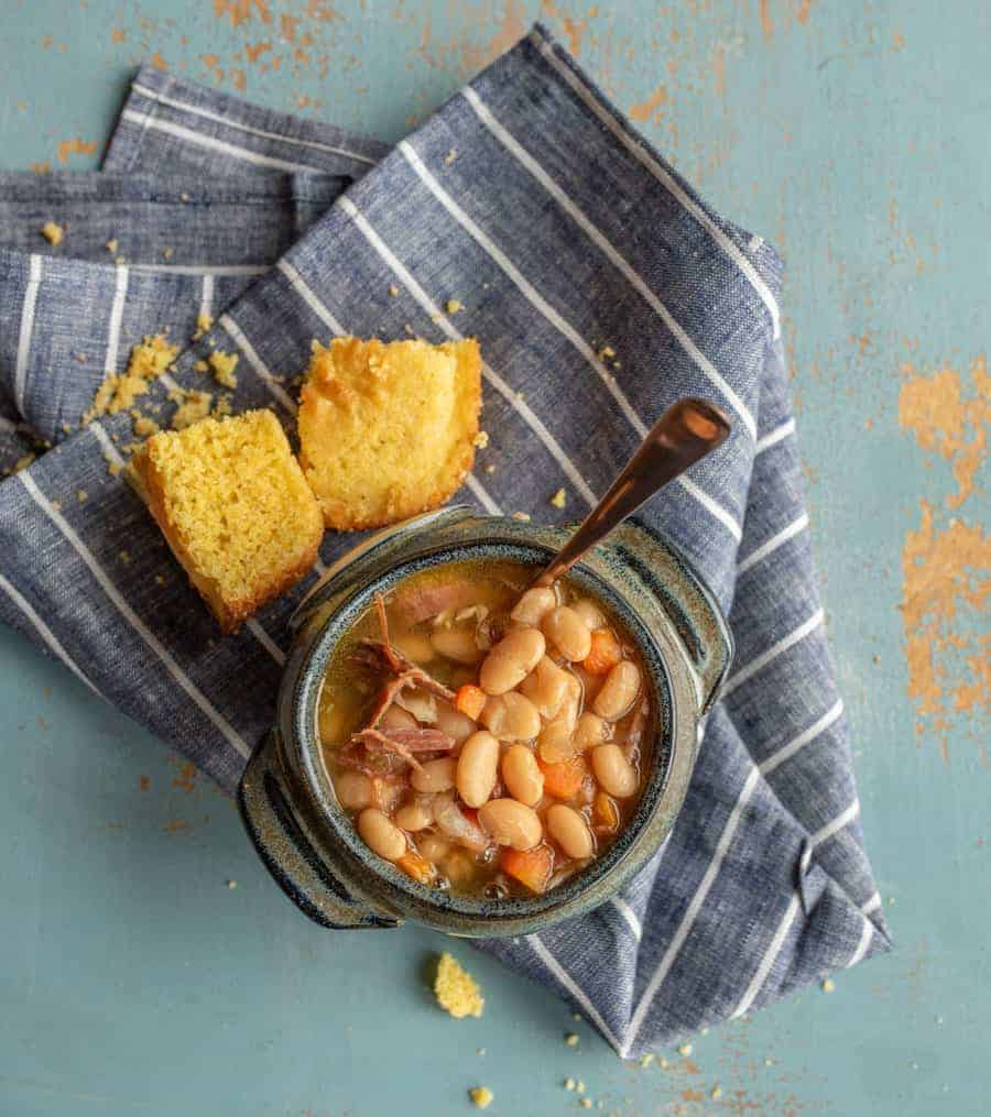 Classic Ham and Bean Soup made in the Instant Pot with ham, dry great northern beans, vegetables, and a few other simple ingredients and cooked in less than an hour thanks to use a pressure cooker.