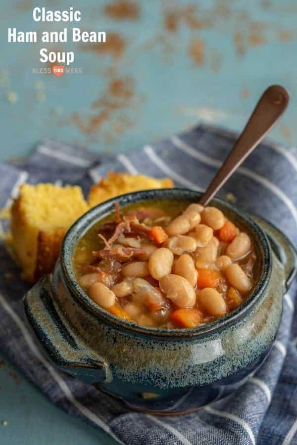 Title Image for Classic Ham and Bean Soup and a crock of ham and bean soup with cornbread on a striped cloth
