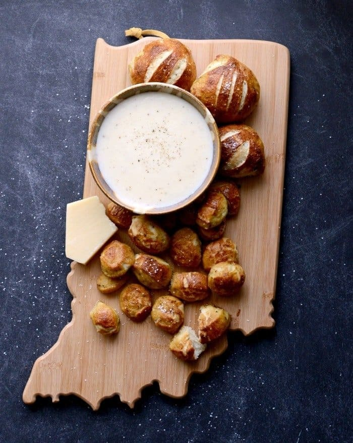 Delicious Parmesan Pretzel Bites made with Italian seasoning and Parmesan cheese dipping sauce make the perfect snack or appetizer.