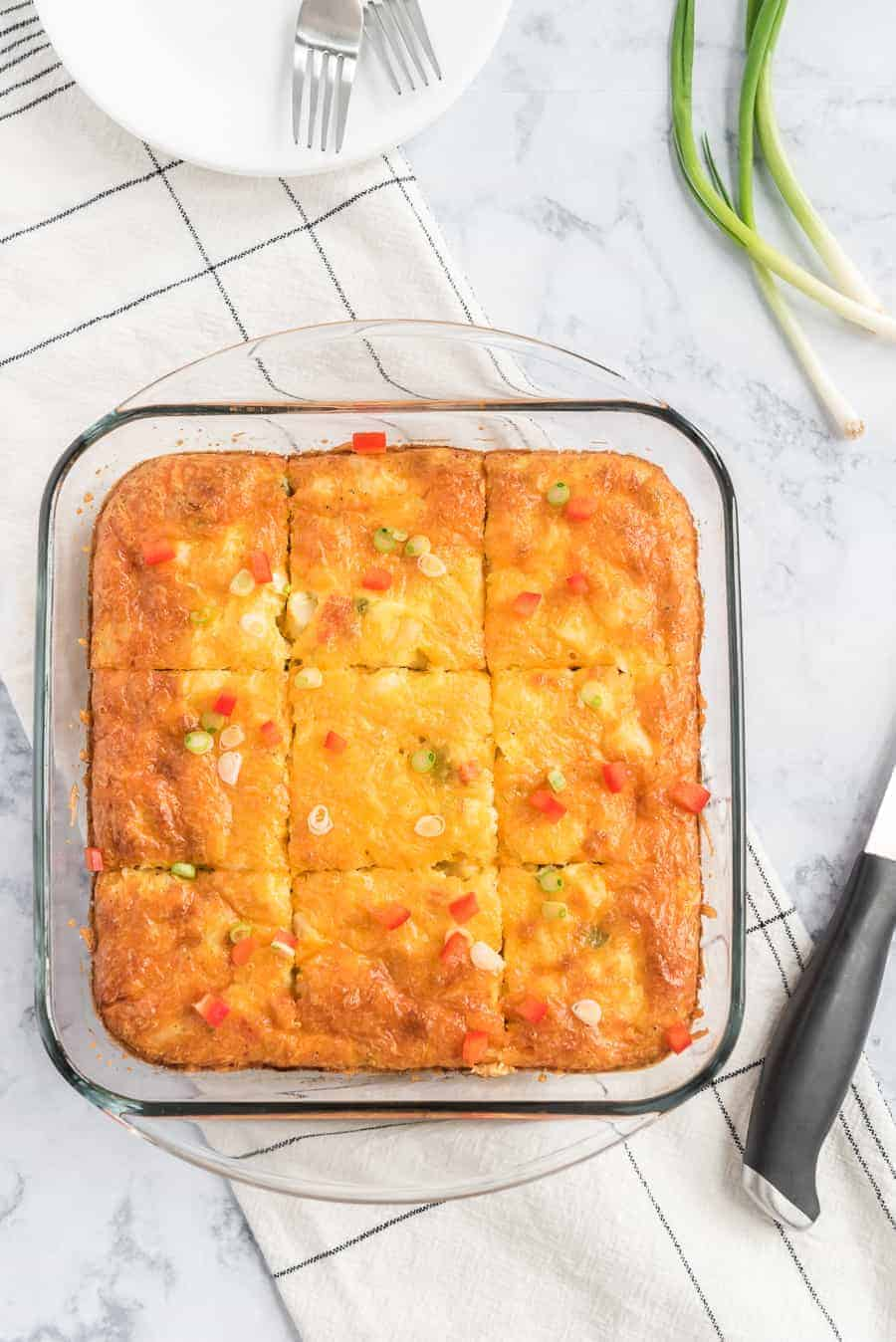 This Easy Egg and Potato Breakfast Casserole will transform your morning with its scrumptious and simple list of ingredients. Eggs, potatoes, and shredded cheddar cheese round out the tasty flavors, with options to personalize it using bacon, sausage, veggies, or garlic powder!