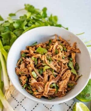 """This crockpot Cafe Rio sweet pork barbacoa recipe is a lifesaver for busy weeknights. I love a good """"toss it all in the slow cooker and forget about it 'til dinner time"""" meal, don't you?"""