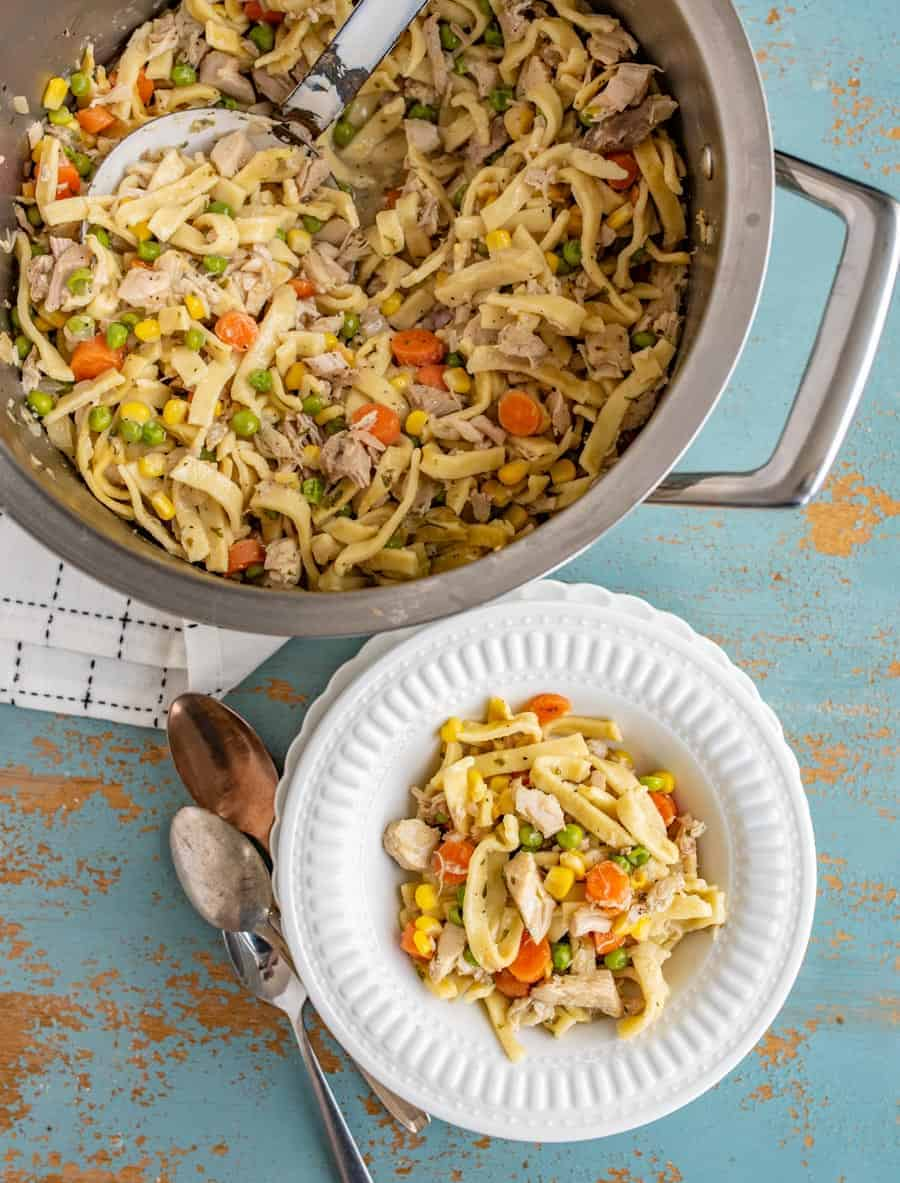 This comforting Chunky Chicken Noodle Soup will brighten any gloomy day and combat any head cold with its hearty combination of shredded chicken (or turkey), egg noodles, carrots, peas, corn, and lots of flavor-packing spices.