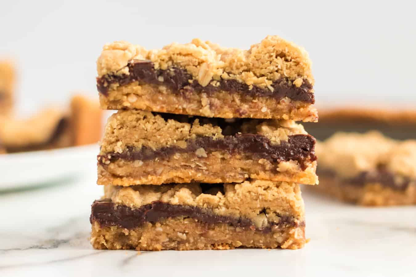 Perfectly equal parts chewy, crusty, and soft, these Peanut Butter Oat Jumbles bars are one of the best chocolate-peanut butter cookie desserts around.