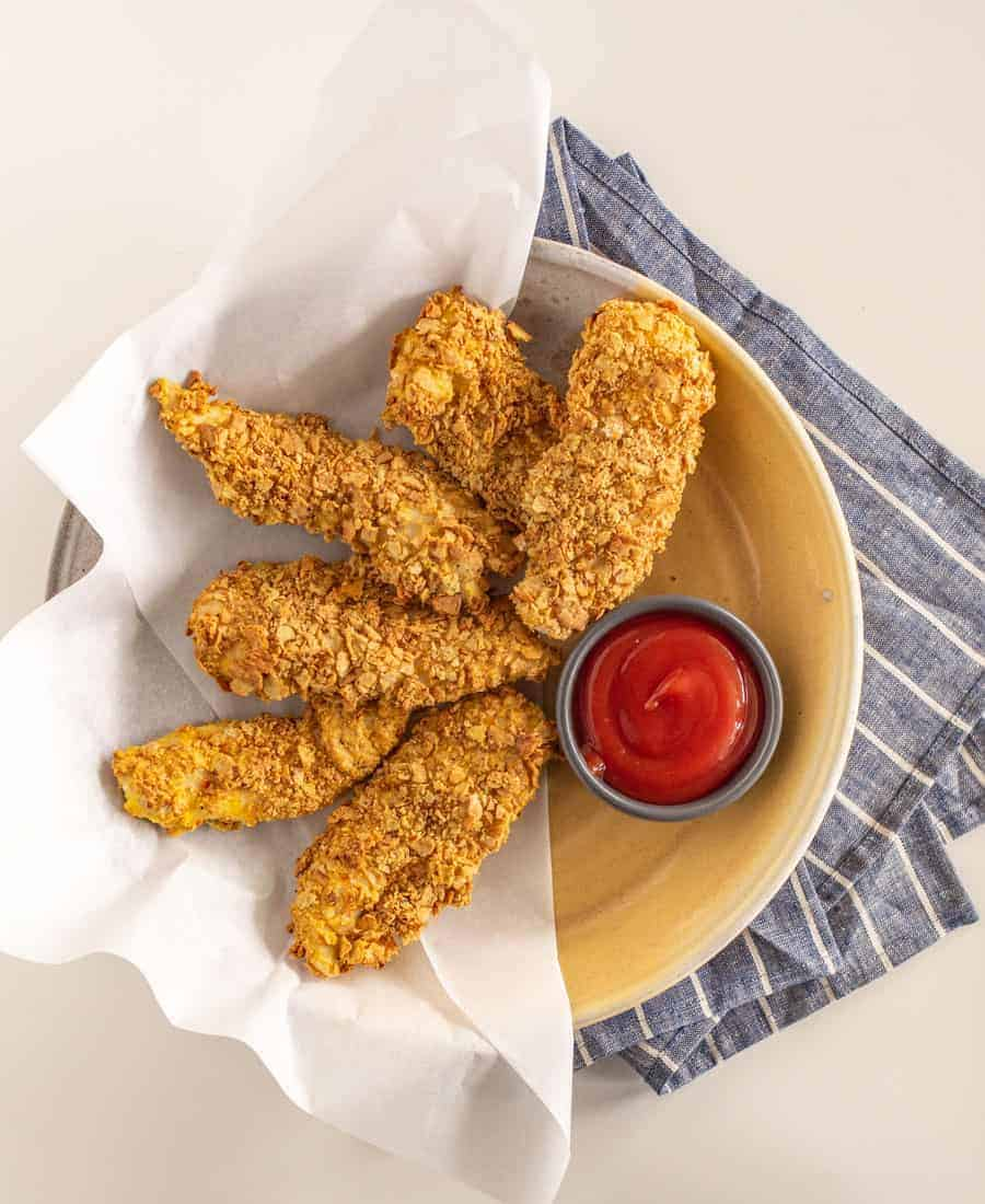 Extra Crunchy Baked Chicken Strips are a delicious spin on fried chicken strips, without the splatter on your stovetop (score!). The Fire Roasted Vegetable flavor of Milton's crackers brings the crunch and full flavor to this seriously delectable dish.