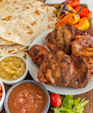 Perfectly seasoned with lime juice, garlic, cumin, chili powder, and smoked paprika, these crave-able Grilled Chicken Tacos are the most satisfying and simple meat you'll ever grill.