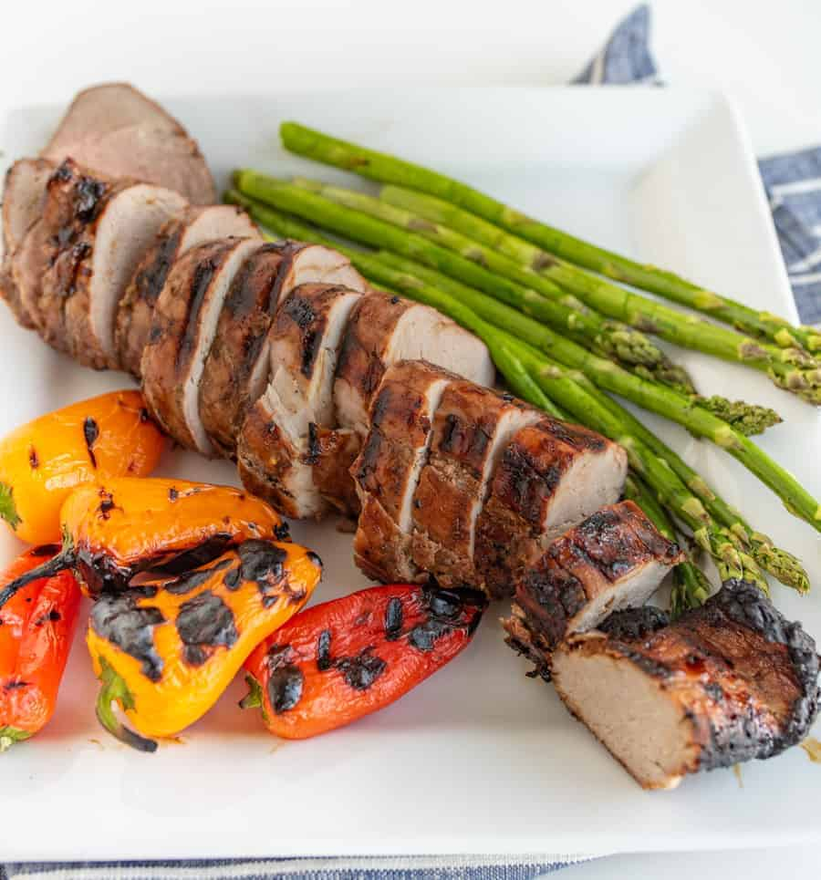 Brown Sugar and Garlic Grilled Pork Tenderloin is robust and smoky with a nice sweet-to-savory ratio. Fire up the grill because this is your new go-to summertime barbecue meat.