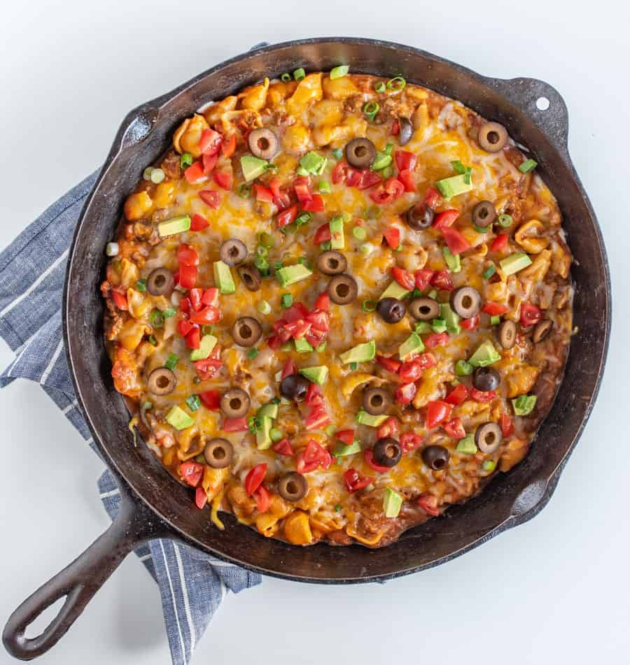 Cheesy, creamy, and packed with shell noodles, ground beef, lots of tomatoes, and all your favorite Tex-Mex toppings, one-pot Skillet Taco Pasta is as dreamy as it is filling and flavorful.