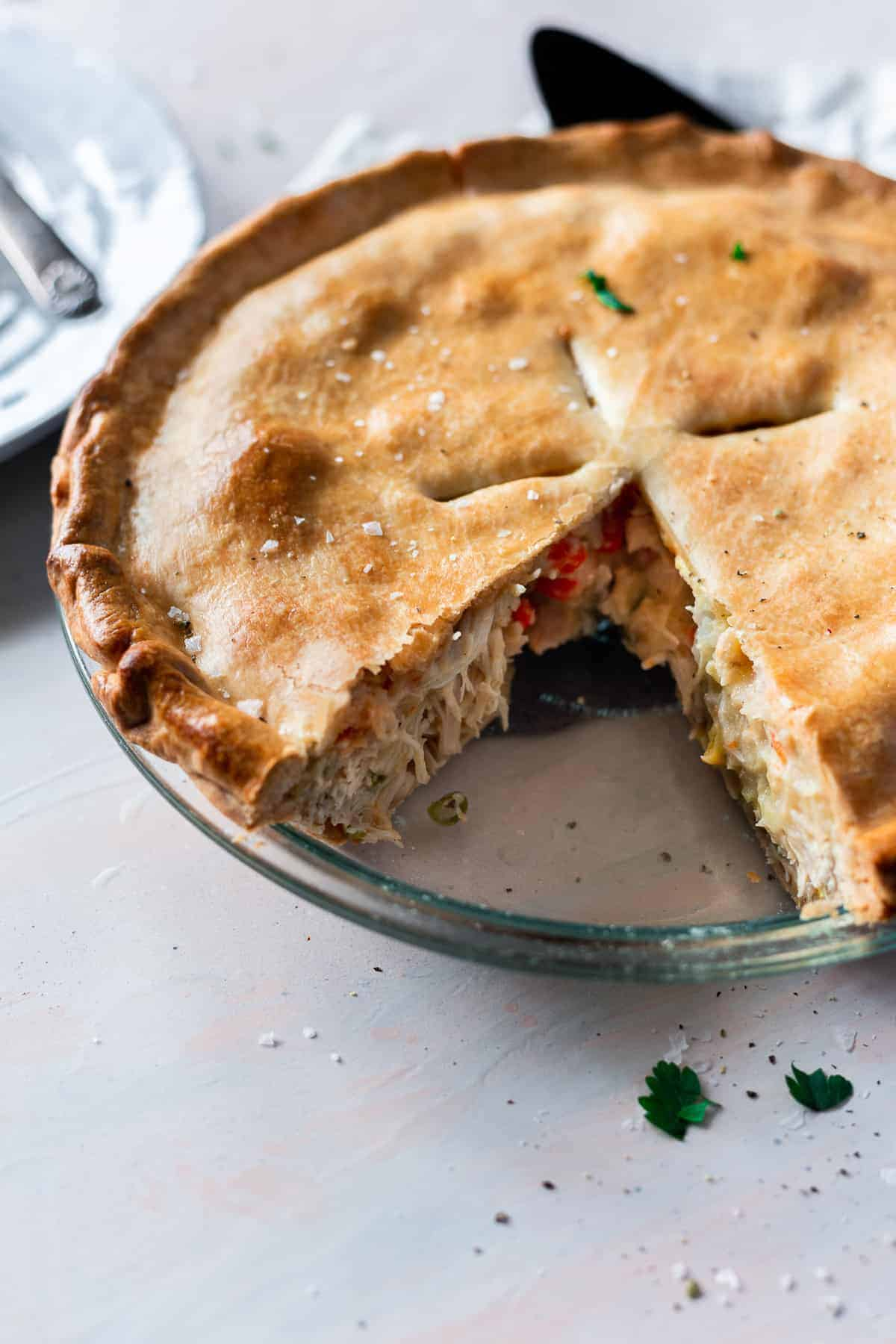 Nothing beats a piping hot homemade chicken pot pie, and this recipe is doable for all levels of home chefs, from novice to expert! I love a simple comfort food recipe, and I've been sharing hundreds of them like this one on my site for years. You can make this chicken pot pie whether you've been cooking your whole life or have hardly touched your oven and want to give a simple recipe a spin! #chickenpotpie #chickenpotpierecipe #potpie #chickenrecipes #comfortfood