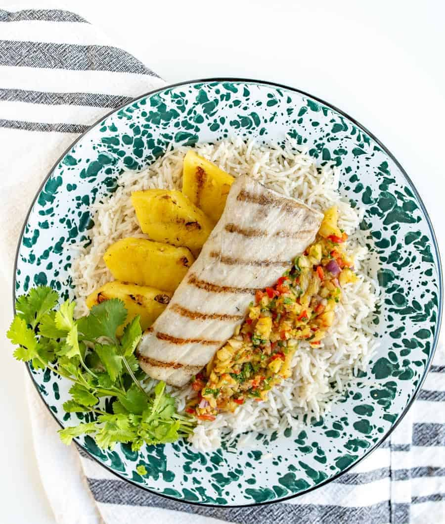 Light and citrusy Grilled Mahi Mahi with Pineapple Salsa is a simple summer meal that has unbelievable flavor and looks beautiful, too!