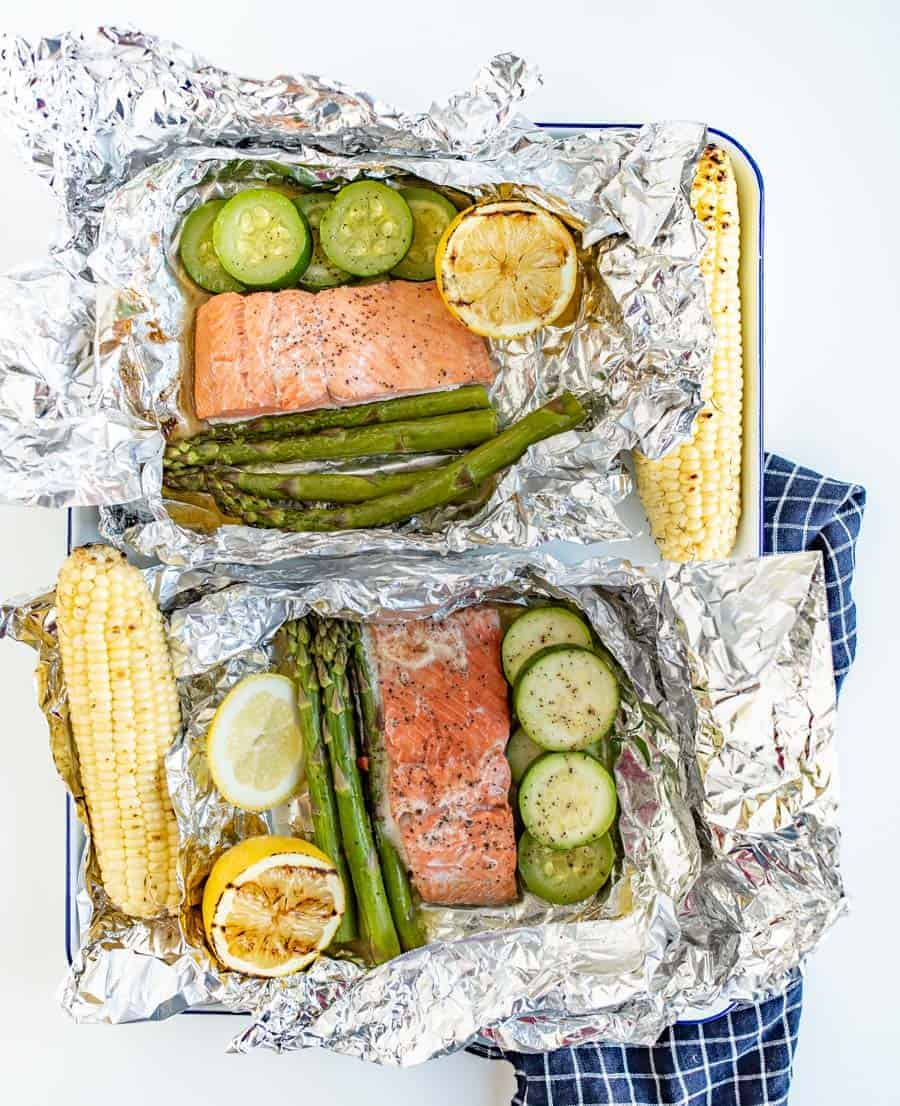 A fresh and fast meal, Grilled Salmon Foil Packs with Veggies couldn't be easier to toss together and grill up quickly with the simple flavorings of some lemon, butter, salt, and pepper.