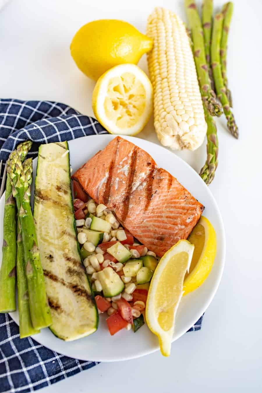 This Easy Grilled Salmon Recipe is perfect for grill novices to learn how to grill salmon. It's flakey, lemony, and salty in all the best ways, and comes together with little time or effort!