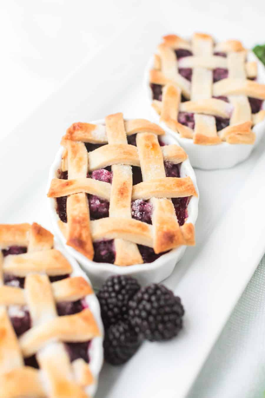 Raspberry cobbler made with black raspberries and a flaky pie crust is a favorite family dessert passed down by my grandmother. #raspberrycobbler #cobbler #raspberry #dessert #baking #familyrecipe