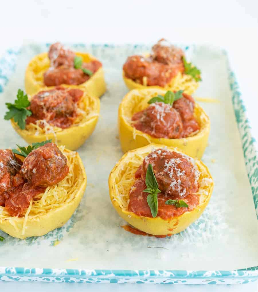 Get ready for the ultimate spaghetti and meatballs switcharoo... This spaghetti squash with meatballs and tomato sauce is just as delicious and flavorful with even more vitamins and nutrients! #spaghetti #spaghettisquash #spaghettiandmeatballs #healthypasta