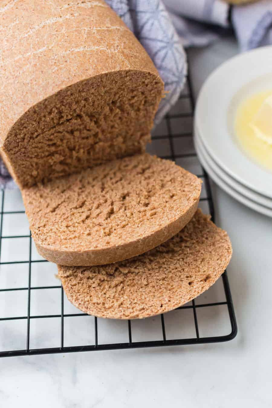 King Arthur classic 100% whole wheat bread is the perfect loaf for all the favorite sandwiches and toast varietals that you and your family love! Don't fret if you've made bread that hasn't worked out in the past... This loaf is so simple to make that you'll be sharing the recipe (and slices) with all your loved ones! #homemadebread #wholewheatbread #wholewheatbreadrecipe #breadrecipe #kingarthurflour #wheatbread #bread #baking
