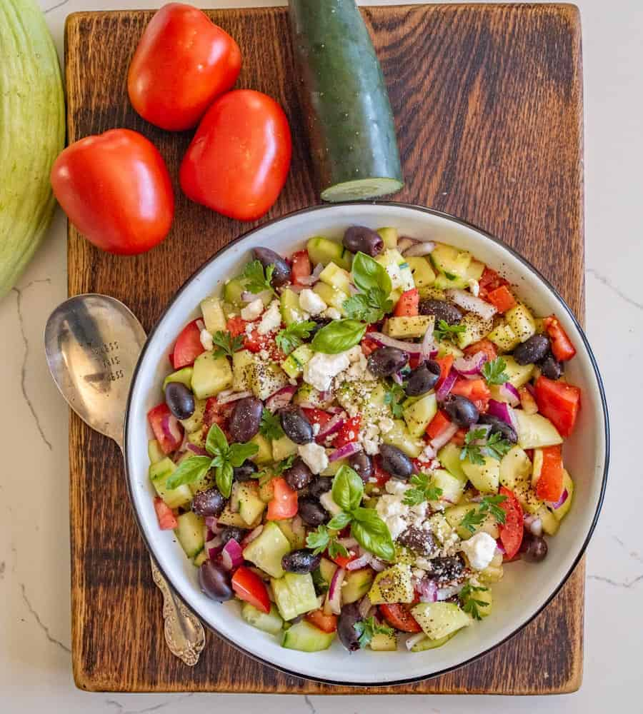 A refreshing and easy taste of summer, this Mediterranean cucumber salad is packed with fresh ingredients and flavors that you can totally make your own! #olives #healthy #salad #cucumber