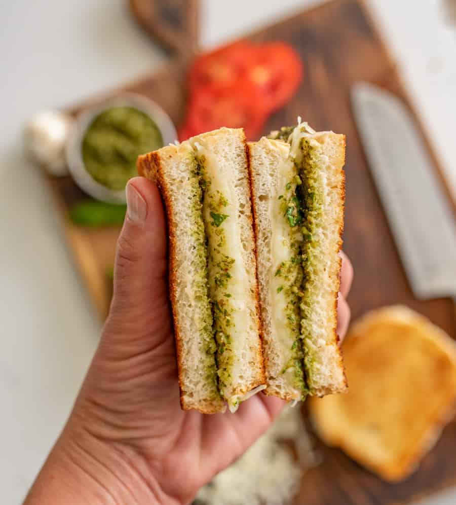 Pesto grilled cheese sandwiches are a super fun and delicious way to simply dress up the classic handheld lunch staple with tried-and-true flavors that taste heavenly together. #grilledcheese #pestogrilledcheese #pesto #sandwich #homemadepesto