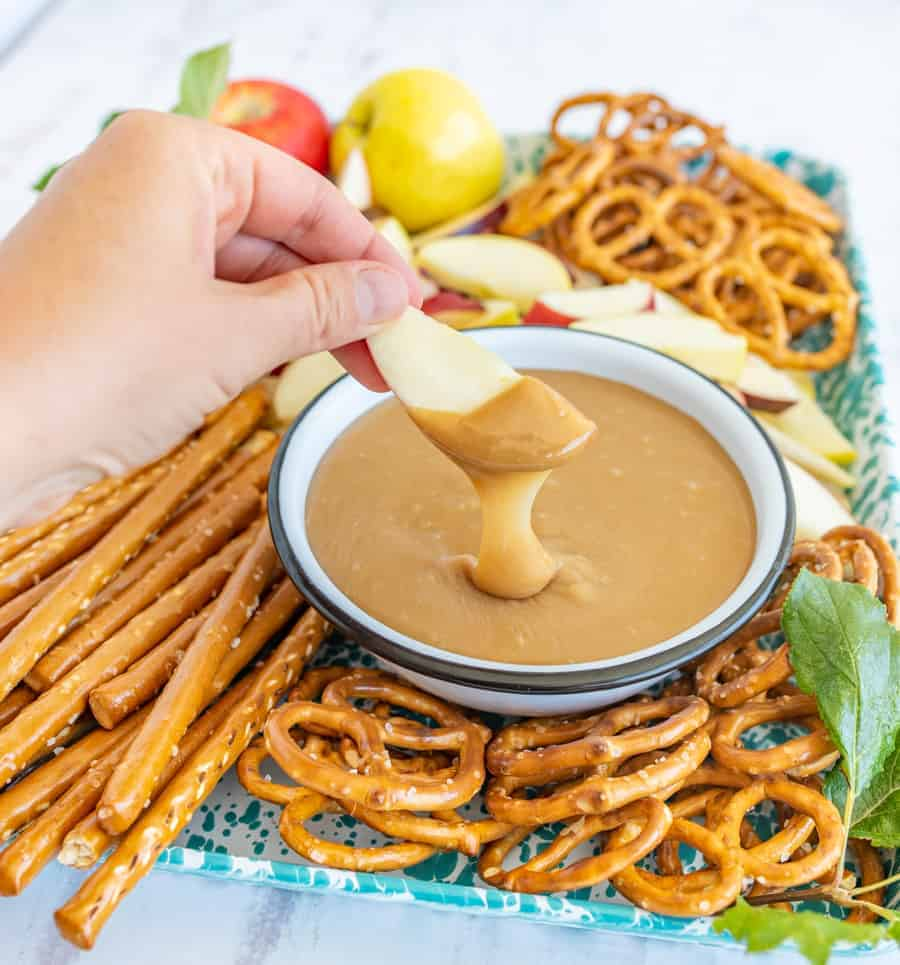 This is the best caramel dip ever. Made on the stove with butter, sugar, and sweetened condensed milk, it's the perfect consistency for dipping pretzels and apples. #homemadecaramel #carameldip #easycaramelrecipe #bestcaramel #thebestcaramel #bestcaramelrecipe #caramelapples #dippingcaramel