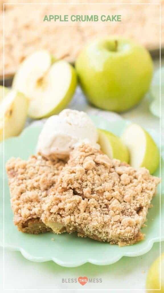 Title Image for Apple Crumb Cake with two squares of apple crumb cake on a plate with vanilla ice cream and apple slices