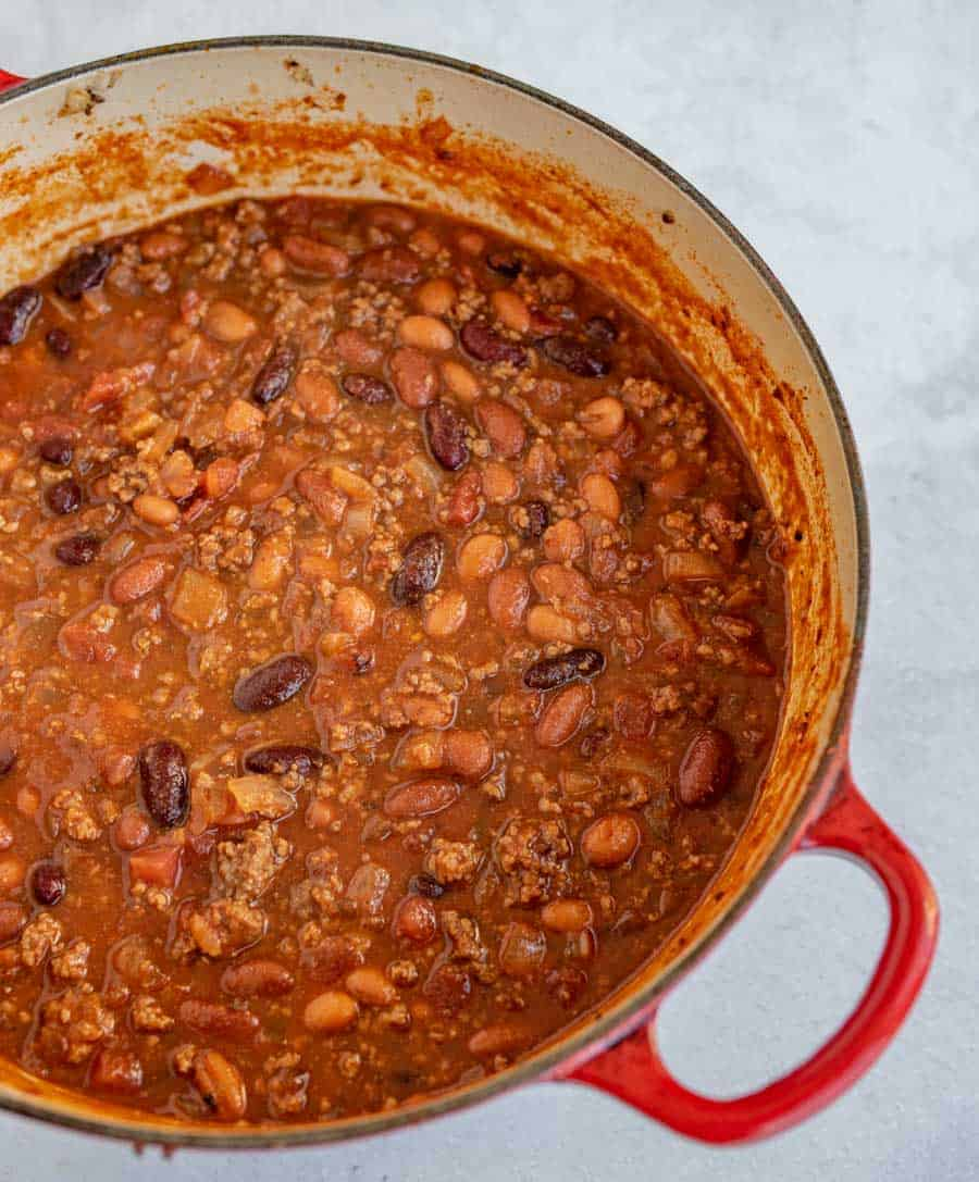 cooked chili in red pot ready to serve