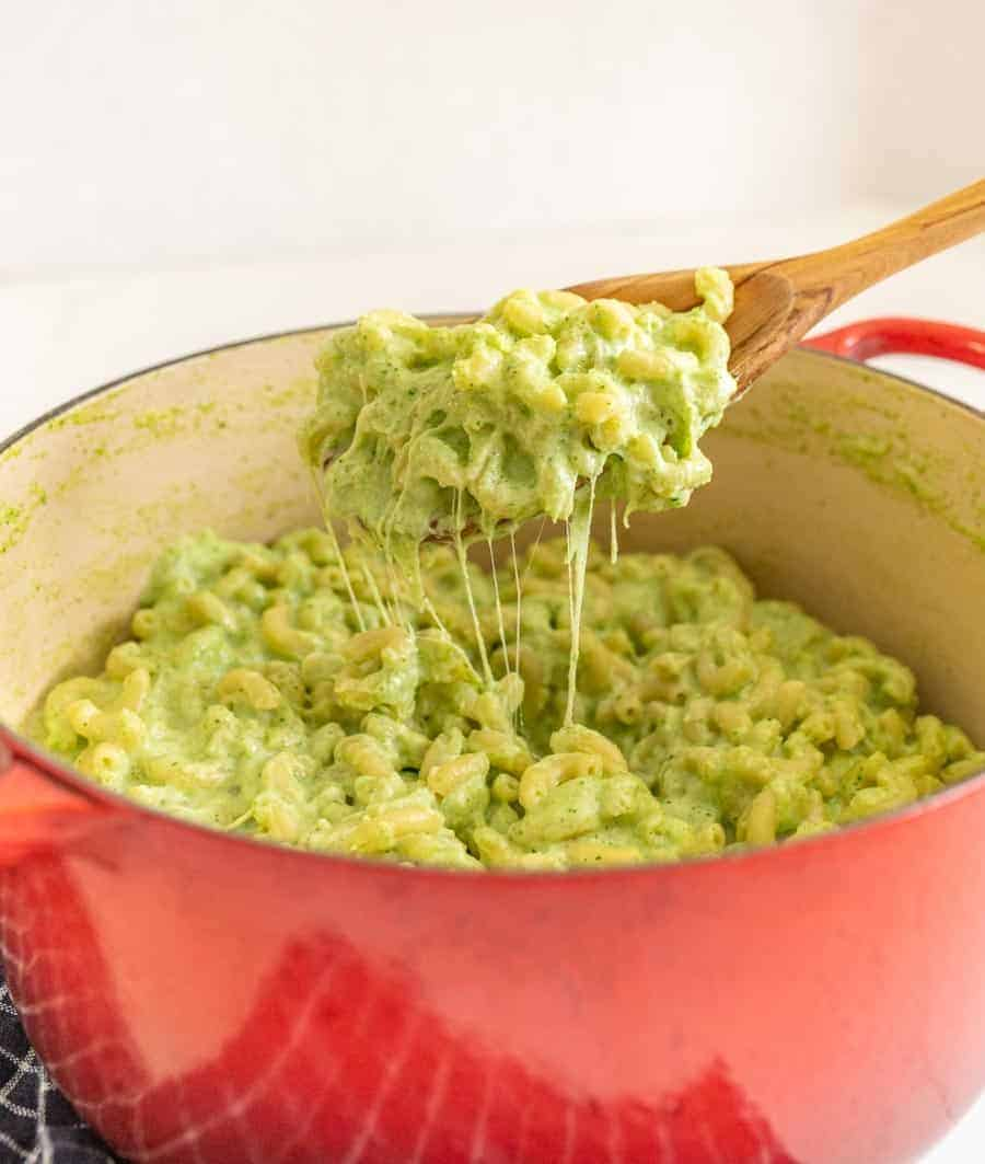 """This delicious broccoli macaroni and cheese recipe is such a fun and creative take on the comfort food staple, and a simple, tasty way to get more green on your plate! It doesn't look like your typical mac and cheese with the green color from broccoli, so I like to break this out around Halloween and call it """"toxic waste mac and cheese"""" for something spooky and fun! #broccolimacandcheese #broccoli #macandcheese #macaroniandcheese #halloweenrecipes"""