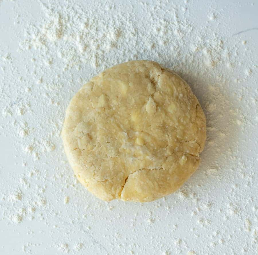 pie crust dough with chunks of butter