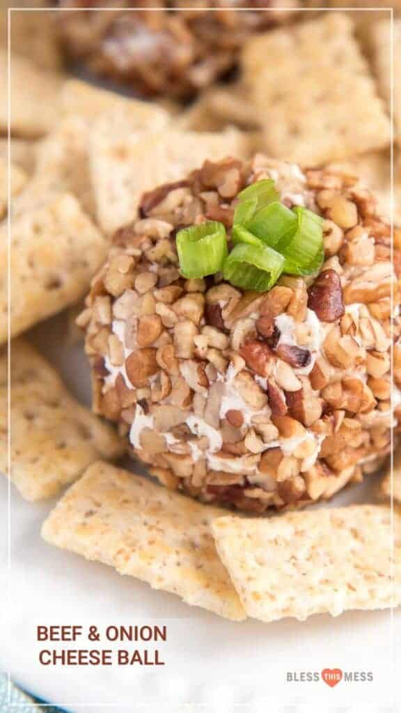 Title Image for Beef & Onion Cheese Ball and a white round plate with a beef and onion cheese ball surrounded by crackers and topped with scallions