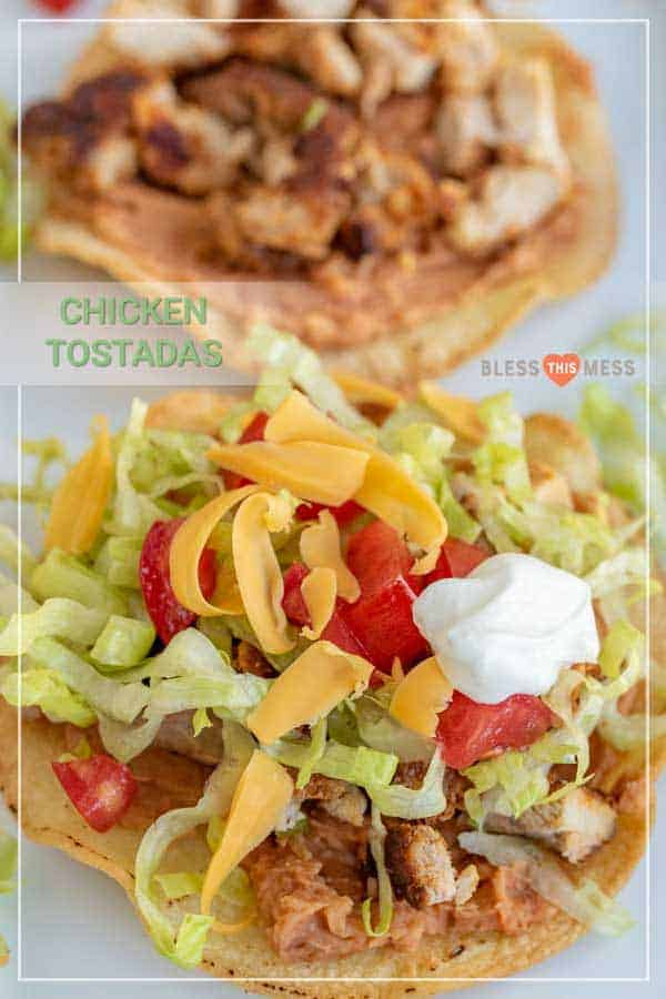 Title Image for Chicken Tostadas and a chicken tostada topped with chicken, shredded lettuce, shredded cheese, diced tomato and sour cream