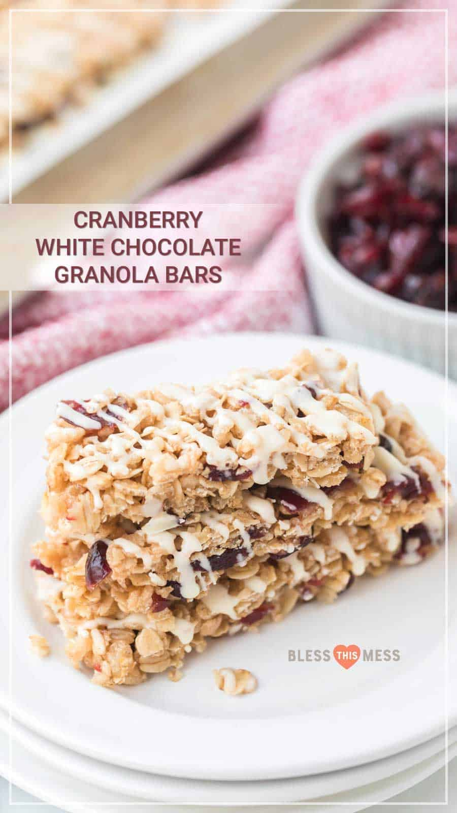 White chocolate and cranberry granola bars are the perfect grab-and-go snack, and they are so simple to make at the beginning of the week to have on the go all week long. I love a granola bar because it's packed with nutrients and vitamins, and these ones taste indulgent even though they're full of nutritious ingredients! #granolabars #homemadegranolabars #cranberrywhitechocolate #proteinbars #snack #homemadesnack #snackrecipes