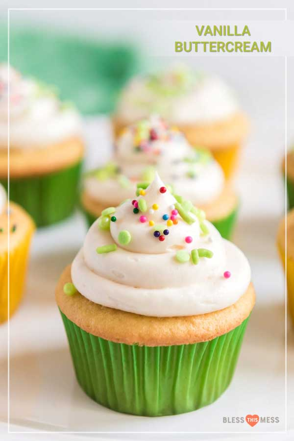 Title Image for Vanilla Buttercream and a vanilla cupcake in a green wrapper with a swirl of vanilla frosting and colorful sprinkles