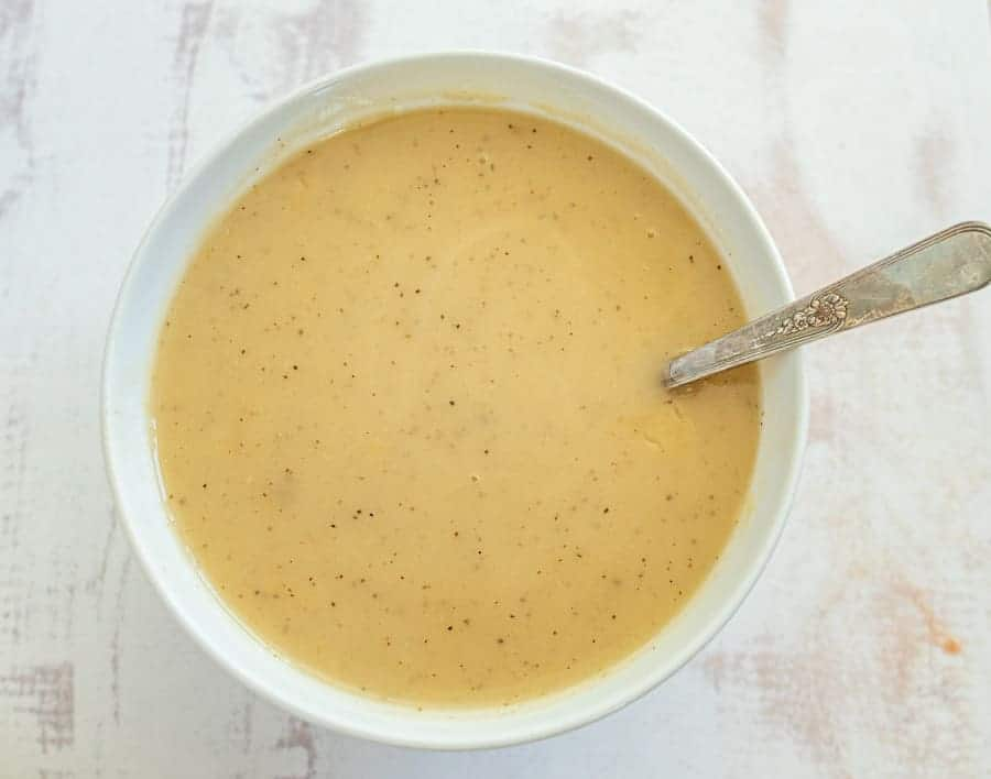 This simple and flavorful homemade gravy comes together quickly using the leftover drippings from a roast turkey or roast turkey breast! You can simply whip this up in a few minutes before you serve a delicious holiday feast to family and friends with the use of a few pantry staple ingredients and the drippings from turkey! #gravy #turkeygravy #thanksgiving #thanksgivingrecipes #homemadegravy #gravyrecipe #holidayrecipes