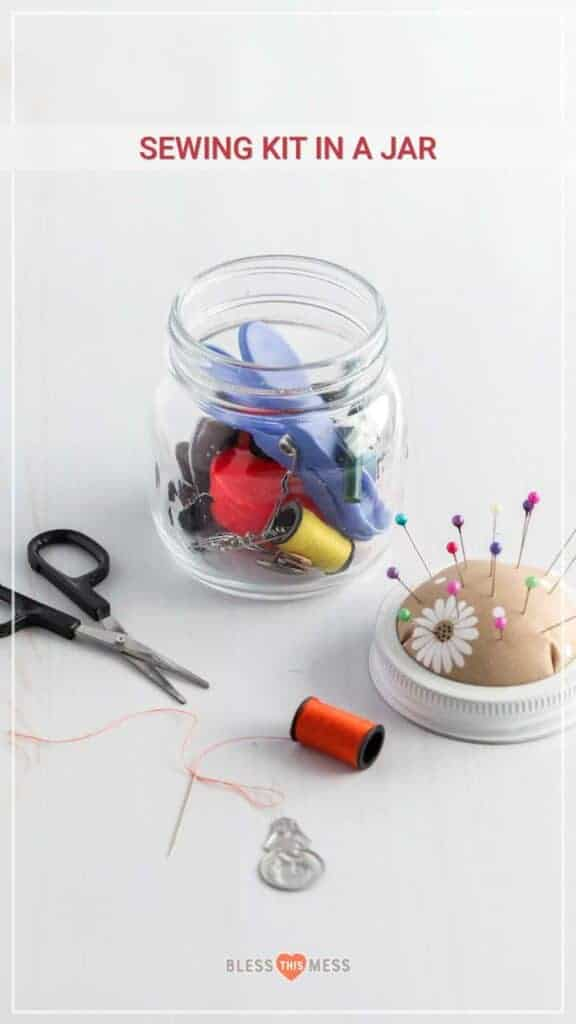 Title Image for Sewing Kit in a Jar, a pin cushion with pins, a needle and thread, scissors, and a small mason jar filled with safety pins, thread, clips,