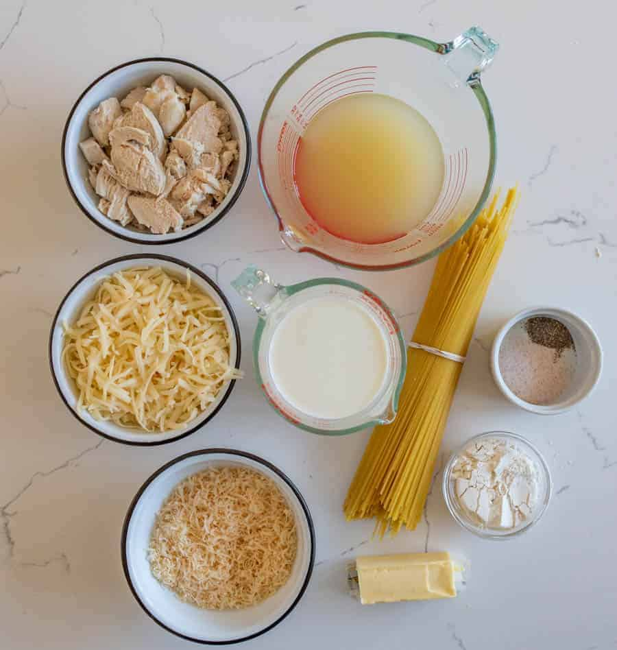 An overhead shot of all the ingredients you will need for turkey tetrazzini, including, turkey, cheese, milk, noodles, butter, etc.