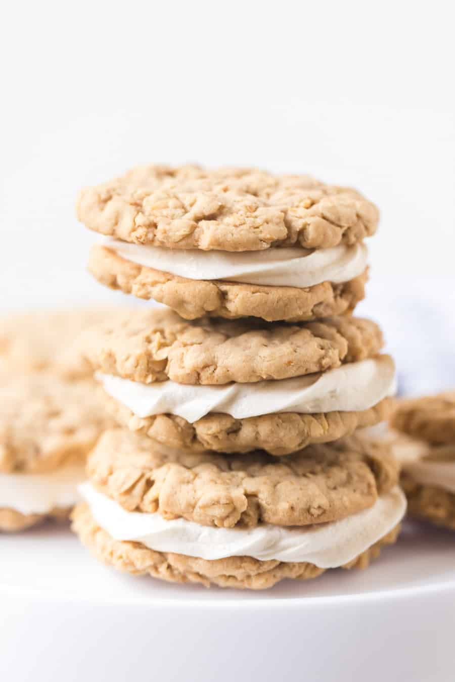 stack of homemade oatmeal sandwich cookies with white background