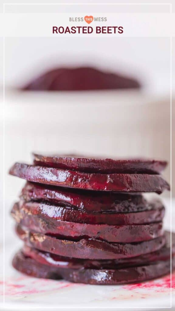 Roasted beets stacked on white plate