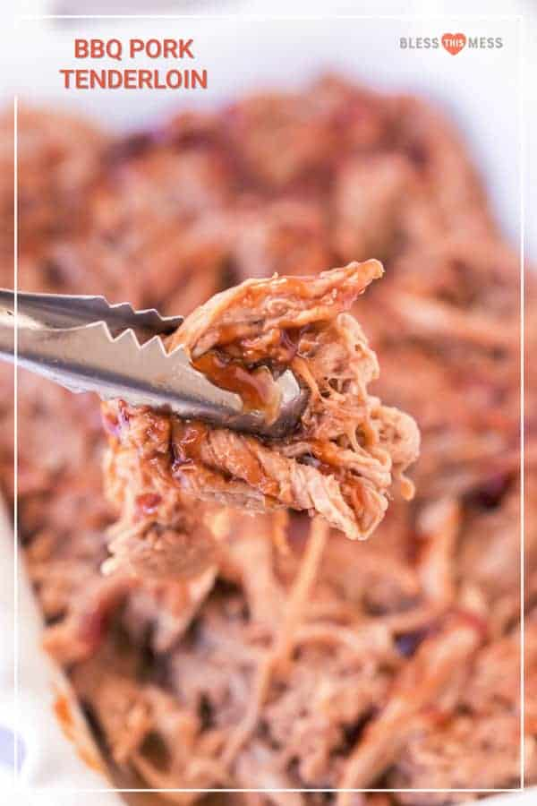 tongs holding bbq pulled pork