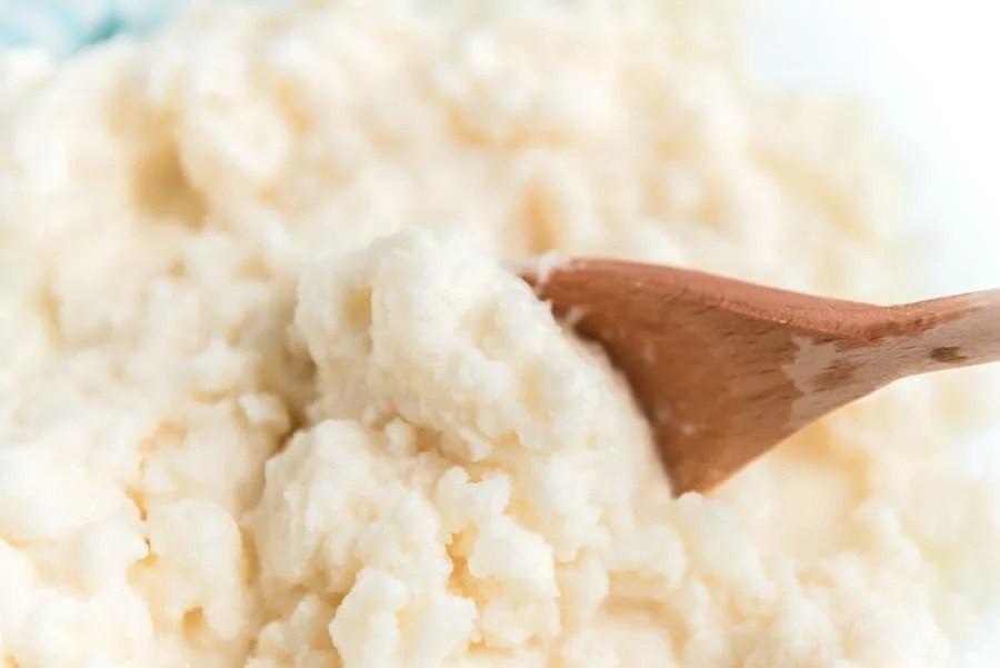 wooden spoon scooping vanilla snow ice cream