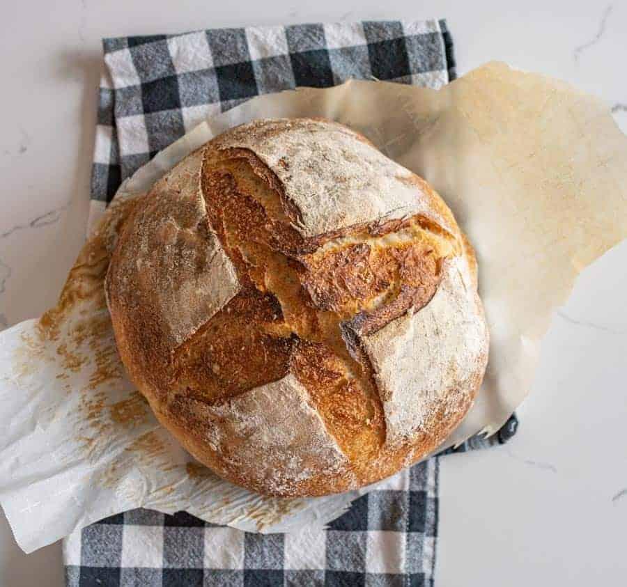 overhead shot of sourdough bread loaf on parchment