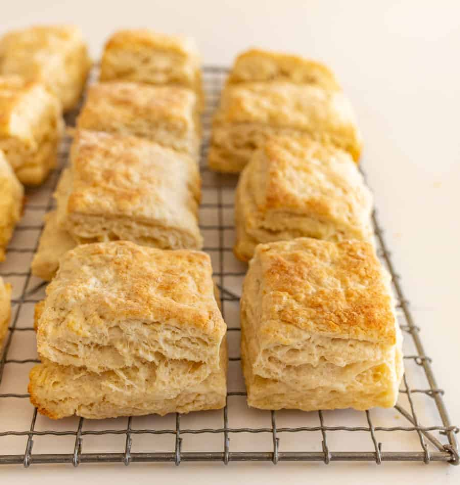 quick sourdough biscuits on cooling rack on white countertop