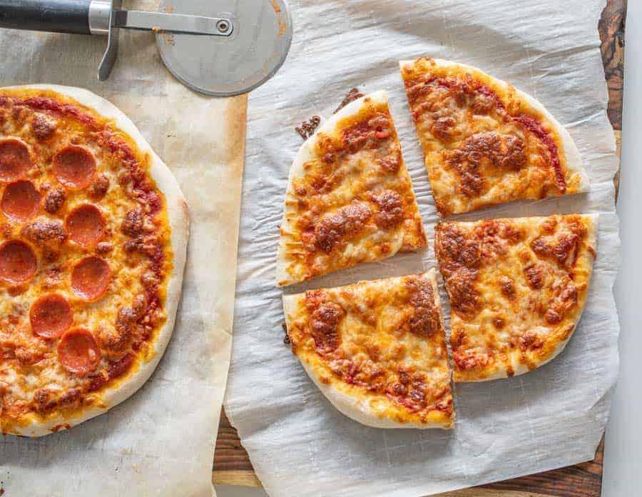 cheese sourdough pizza and pepperoni sourdough pizza