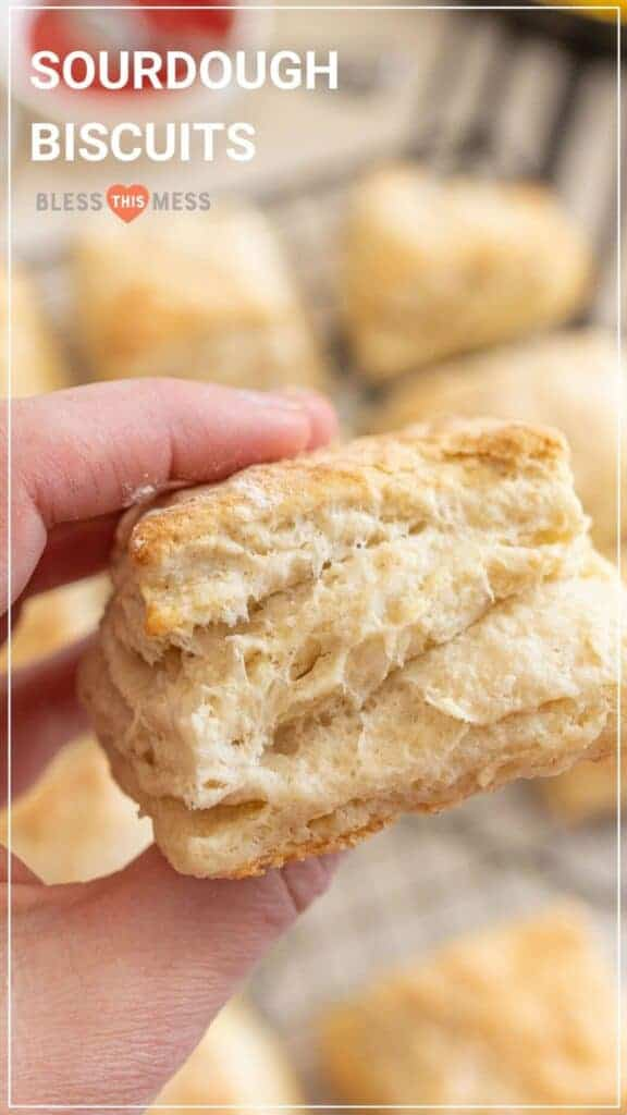 woman holding sourdough biscuit